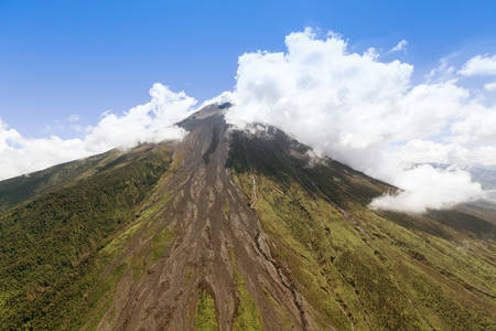aerial shot of tungurahua volcano, central ecuador, high altitude from full size helicopter.