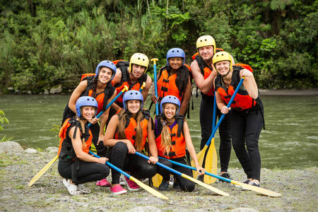 lifejacket: group photo of white water rafting group before the departure, specific equipment