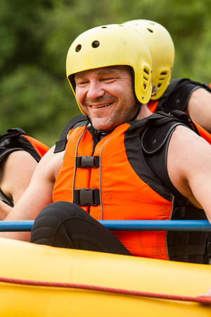 smily face: portrait of adult man in white water rafiting boat, smily face Stock Photo