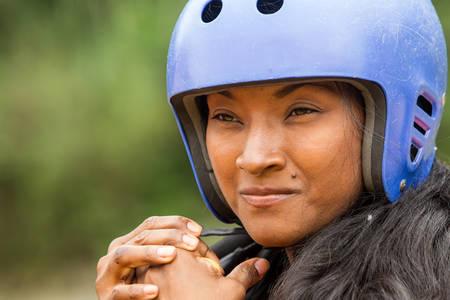 lifejacket: closeup of afro lady wearing protective sport helmet