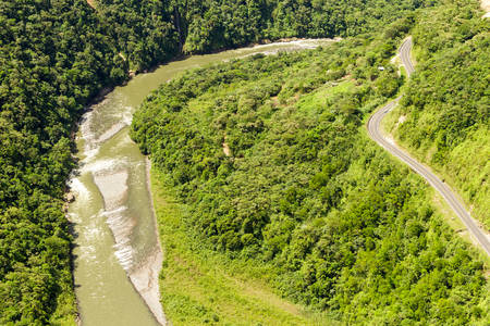 high size: Pastaza river valley in Ecuadorian Andes and Pan American road, high altitude full size helicopter shot