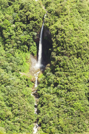 poi: Machay waterfall and Pan American highway in Ecuadorian Andes