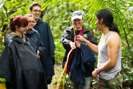 adventurers: Naturalist local guide with group of tourist in Cuyabeno Wildlife Resrve, Ecuador Stock Photo