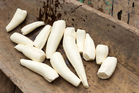 yucca: Cassava or yuca roots cleaned up and peeled in thraditional wood container