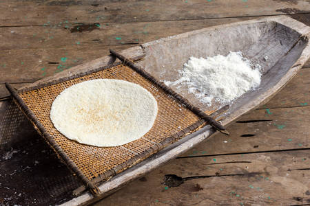 Cooked cassava pie and grinded root, indigenous cooking style