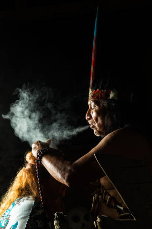 shaman: Shaman in Ecuadorian Amazonia during a real ayahuasca ceremony, model released image, as seen in April 2015