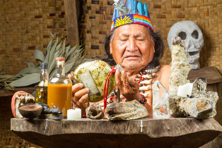 model released: Shaman in Ecuadorian Amazonia during a real ayahuasca ceremony, model released image, as seen in April 2015