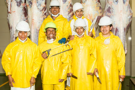 sadism: Slaughterhouse team of six butcher with their specific tools, group photo