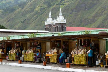sidewalk sale: Banos De Agua Santa, Ecuador - 02 January 2012: Sugarcane Sellers Waiting For Their Clients On The Streets In Banos De Agua Santa On January 02, 2012