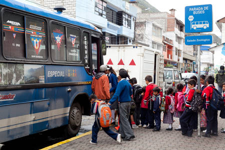 busses: Banos De Agua Santa, Ecuador - 12 August 2012: Group Of Young Children Waiting For The Old Bus That Will Take Them Home In Banos De Agua Santa On August 12, 2012