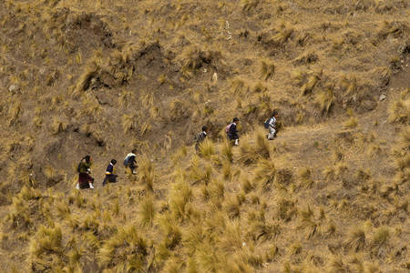difficult lives: Saquisili, Ecuador - 17 October 2012: Mother With Kids Getting Back From The School On A Steep Slope In Ecuadorian Andes In Saquisili On October 17, 2012 Editorial