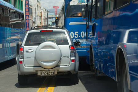 busses: Ambato, Ecuador - 24 January 2014: Aggressive Driving Busses Drivers Not Respecting Priority Rules On The Streets In Ambato On January 24, 2014 Editorial