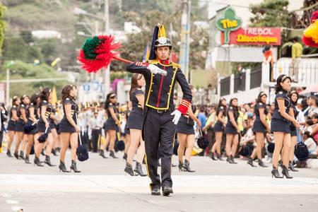 festival moment: Banos De Agua Santa, Ecuador - 26 July 2015: Proud High School Student Leading The Festivity For The Summer Break In Banos De Agua Santa On July 26, 2015