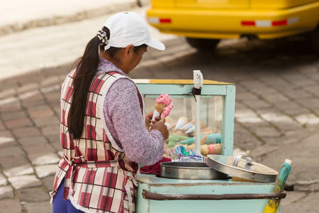 calories poor: Ambato, Ecuador - 24 January 2014: Ice Cream Seller While Modern Sanitation Laws Exists Local Authorities Does Not Enforce Them On The Streets In Ambato On January 24, 2014