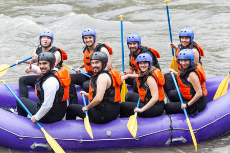 whitewater: Group Of Mixed Young Tourists Striking A Pose Before Whitewater Rafting Trip
