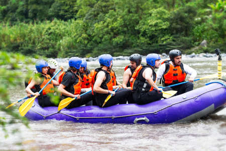 rafting: Group Of Tourists Getting Ready For A Whitewater Rafting Trip Stock Photo