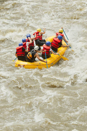 river rafting: Group Of Mixed Tourist Men And Women With Guided By Professional Pilot On Whitewater River Rafting In Ecuador