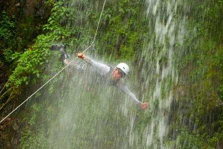 extreme sports: Canyoning On Pucayacu River Canyon Near Banos Ecuador