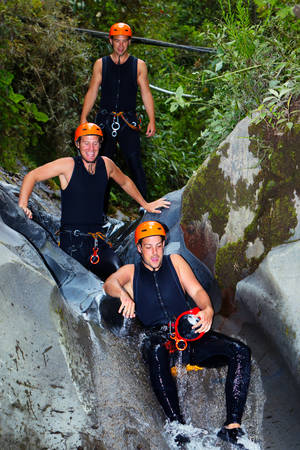 rappel: Three Enthusiast Tourist On Canyoning Trip