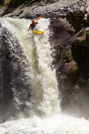 black white kayak: Waterfall Kayak Jump Sangay National Park Ecuador