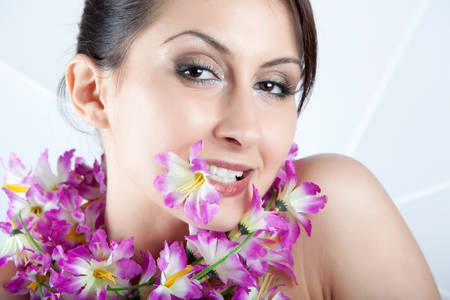 artificial model: Artificial Flowers Garland On A Female Model Stock Photo