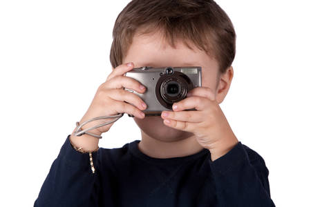 snapshot: Kid Using A Small Digital Photo Camera In Classic Snapshot Position