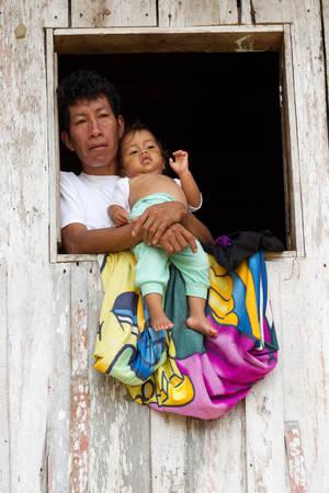 amazonia: Father And Son At Their Shack Window In Ecuadorian Amazonia