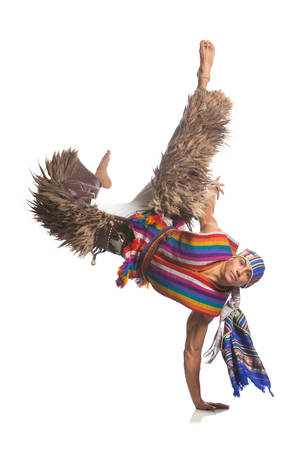 ecuadorian: Ecuadorian Dancer Dressed Up In Traditional Clothing From The Andes Performing A Jump Llama Or Alpaca Pants Studio Shot Isolated On White