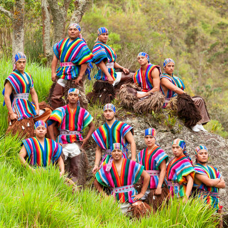 group shot: Ecuadorian Folkloric Group Dressed Up In Traditional Costumes Outdoor Shot Stock Photo