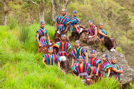 outdoor shot: Ecuadorian Folkloric Group Dressed Up In Traditional Costumes Outdoor Shot Stock Photo
