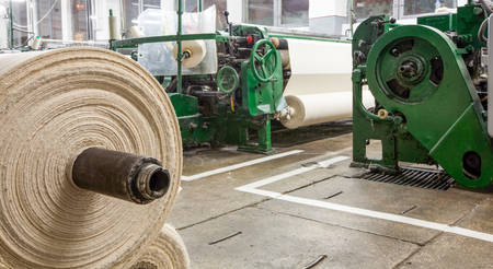 machines: Textile Factory With Roll In Foreground And Machines In Background