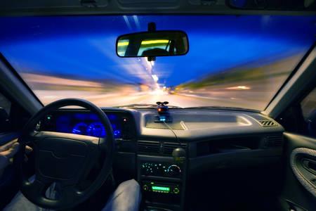 View From Windscreen Of A Car Speeding In The Night Standard-Bild