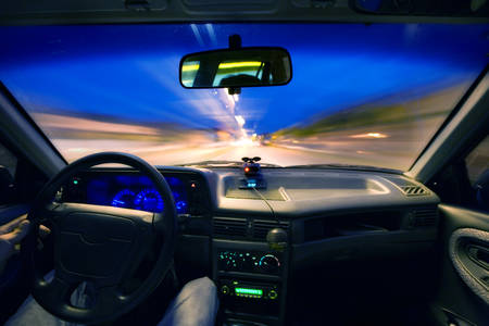 speeding: View From Windscreen Of A Car Speeding In The Night Stock Photo