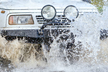 4x4: 4X4 Car Off Road Driving Into The Water Stock Photo