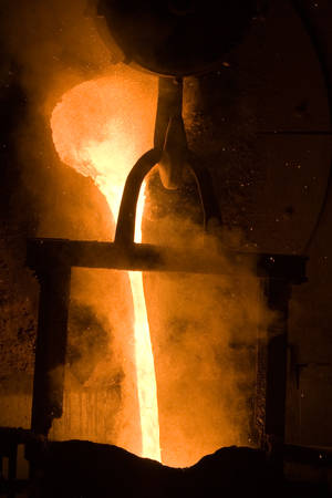 smelter: Molten Iron Flowing From The Smelter Pot Stock Photo