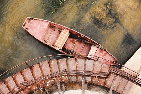 corrosion: Rusted Boat Against Danube Water Aerial View Stock Photo