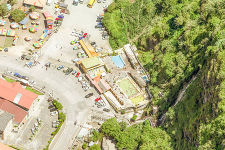 altitude: Aerial Vertical Shot From High Altitude Of A Touristic Complex In Banos De Agua Santa