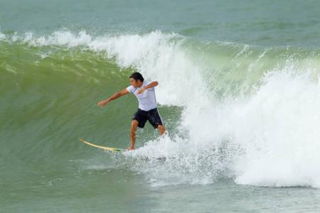 balsa: Young Man Surfing On A Balsa Surfboard