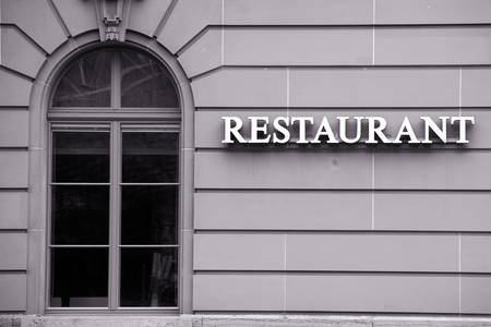 tripod mounted: Restaurant Windows Along The Text Medium Telephoto Lens On Tripod Mounted Camera Stock Photo