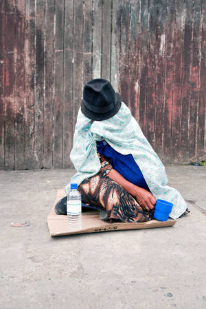 black hat: Woman Bagging On The Street In Quito Ecuador