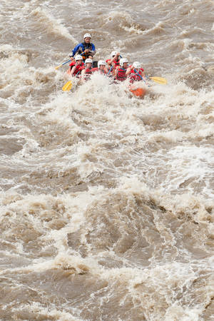 persevere: Group Of Mixed Tourist Men And Women With Guided By Professional Pilot On Whitewater River Rafting In Ecuador