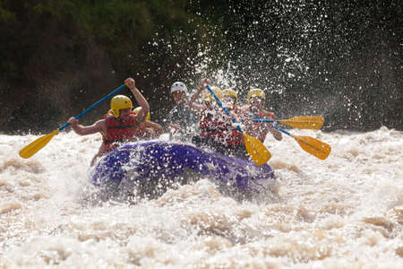 the rivers: Group Of Mixed Tourist Men And Women With Guided By Professional Pilot On Whitewater River Rafting In Ecuador