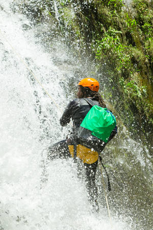 rappel: Canyoning Guide Trying Out A New Route In Chama Waterfall Banos De Agua Santa Ecuador Stock Photo