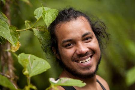 latin man: Latin Man Laughing Against Green Natural Background
