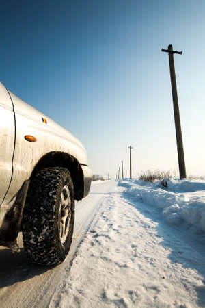 foreground: Winter Road Perspective With An Off Road Tire As Foreground Stock Photo