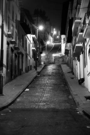 notorious: Black And White Night Image On The Outskirts Of Quito Neighborhood Well Known For High Crime Rate Stock Photo
