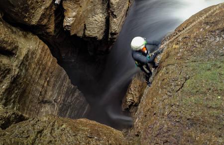 extreme sports: Speleologist Underground Work Stock Photo