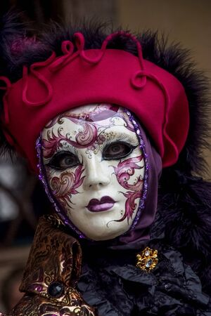 VENICE, ITALY - JANUARY 29, 2008: Unidentified person with Venetian carnival mask in Venice, Italy. At 2008 it is held from January 26th to February 5th. photo