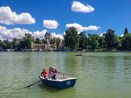 MADRID, SPAIN - JUNE 1, 2014: Unidentified people at Buen Retiro Park in Madrid, Spain. It is the one of the largest parks of the city of Madri. Editorial