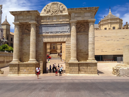ruiz: CORDOBA, SPAIN - JUNE 5, 2014: Unidentified people by the Gate of the Bridge (Puerta del Puente) in Cordoba, Spain. It is a Renaissance gate constructed by architect Hernan Ruiz III.